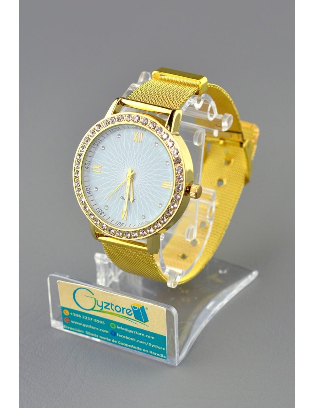 Reloj dorado con fondo jaspe y números romanos