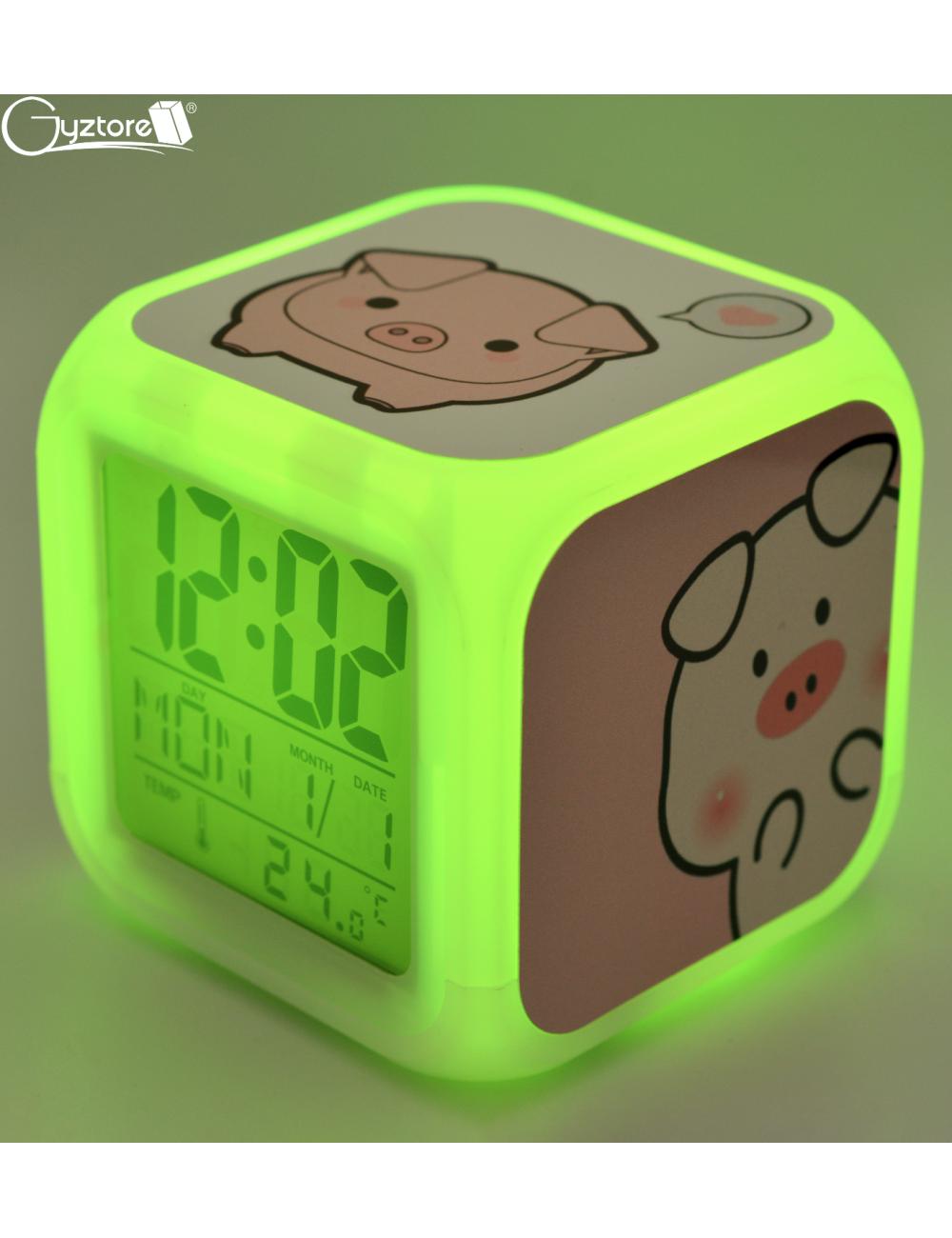 """Relojes digitales """"Chanchito"""" con LED multicolor"""
